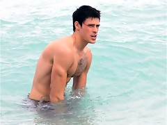 Adam Gregory is topless at the beach showing nice upper body