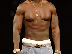 Rapper 50 Cent flashing his nice pecs and big guns