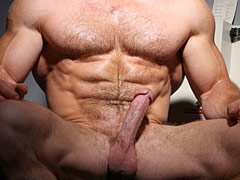 Hairy muscle man jacks off