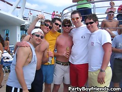 Party boys are on the beach having some fun with hot chicks