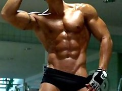 Hunk dude with nice muscular body is dancing around outdoor