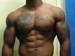 Hunk dude pulls up his top clothes showing off his abs