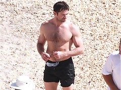 Paparazzi shots of Hugh Jackman showing his sexy torso