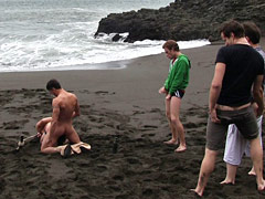 Amateur video of Micah Andrews being used and abused on a public beach