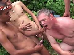 Asian watersports lads, cover European guy in a river of steamy yellow piss.