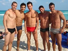 Young guys with hot bodies teasing well on the beach for fun